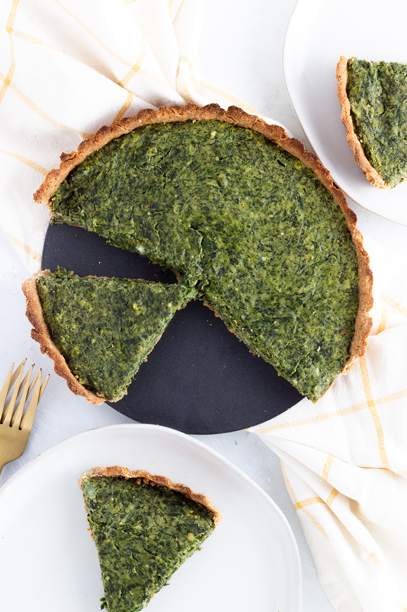 There's a secret ingredient to this Spinach Goat Cheese Tart filling. White beans help give this tart a creamy texture plus an extra serving of protein.