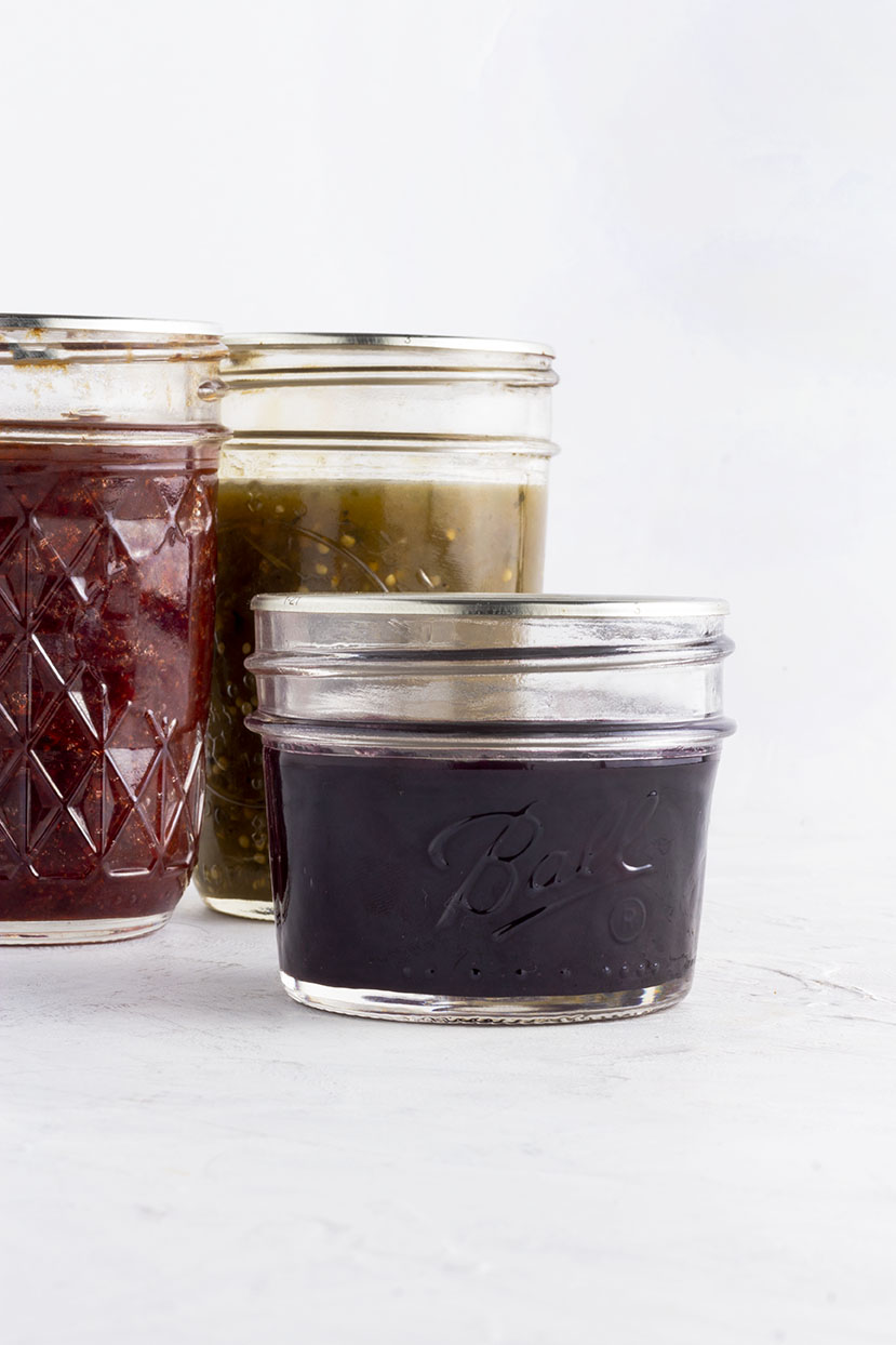 Ready to be stored away, these jars of jam and salsa celebrate all the beautiful summer produce (Blueberry Ginger Jam, Salsa Verde & Strawberry Ginger Jam).