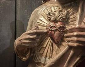 Sacred Heart  of  Jesus: infinite love ( Detail of carved vintage statue)