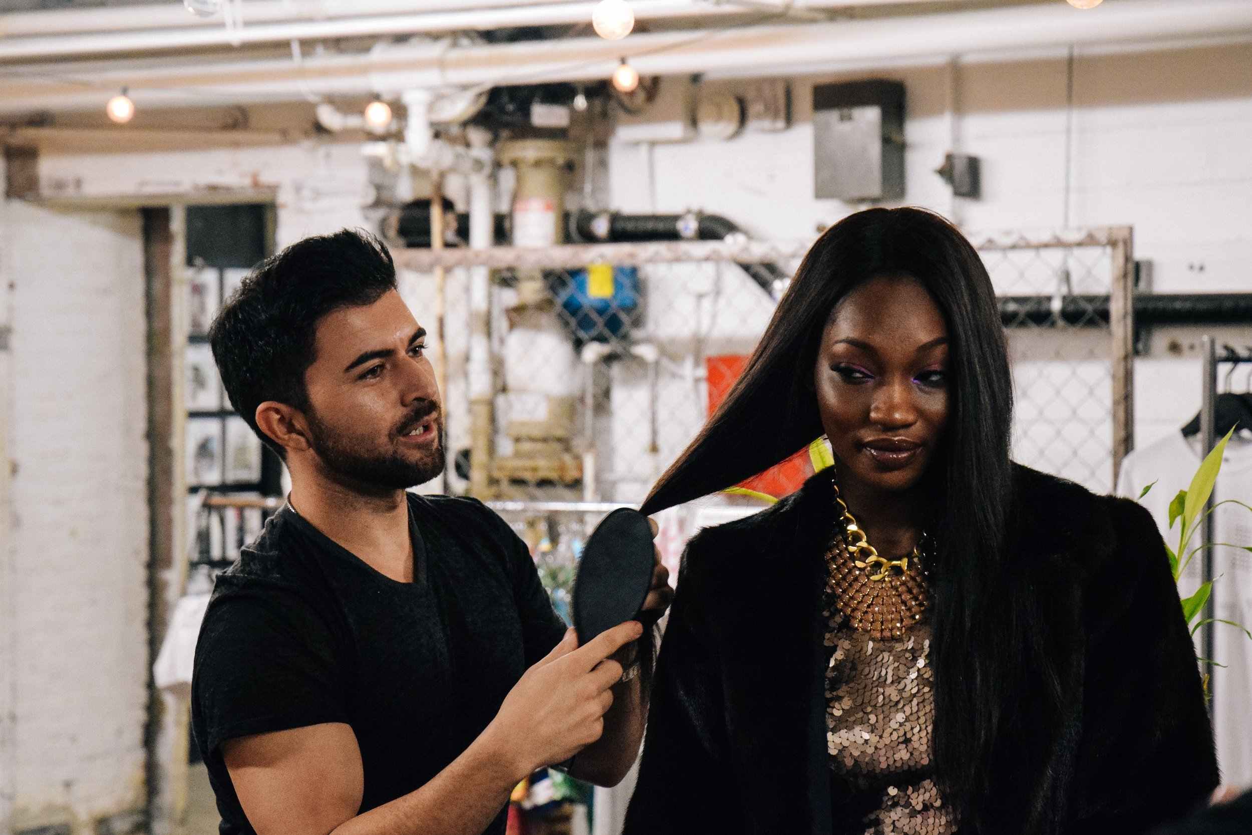 Model Arame being styled by Marcos Haro of Luxelab