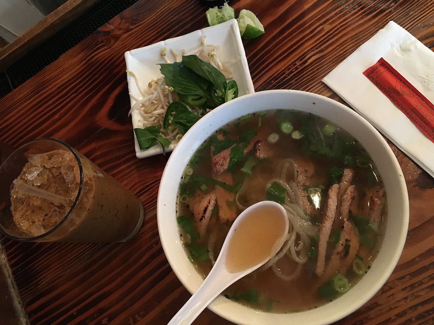 My favorite vietnamese restaurant,  Saigon Shack.  It sounds like a jenkie spot, but it's one of the BEST in NYC. If you are ever in NYC, stop by  Saigon Shack ! What you are looking for is pork chop pho.