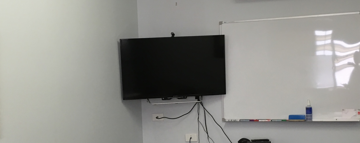 TV mounted to gyprock wall in the meeting room of a Toowoomba business