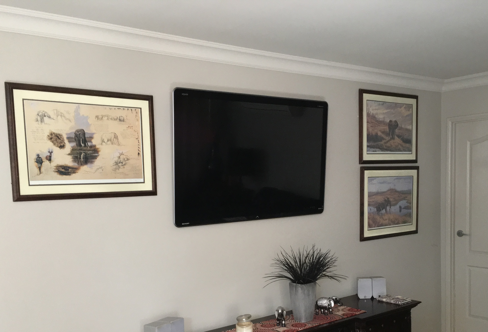 Large TV mounted to a cavity wall in a home in Highfields,when the TV cables have been run in the wall behind the plaster board.