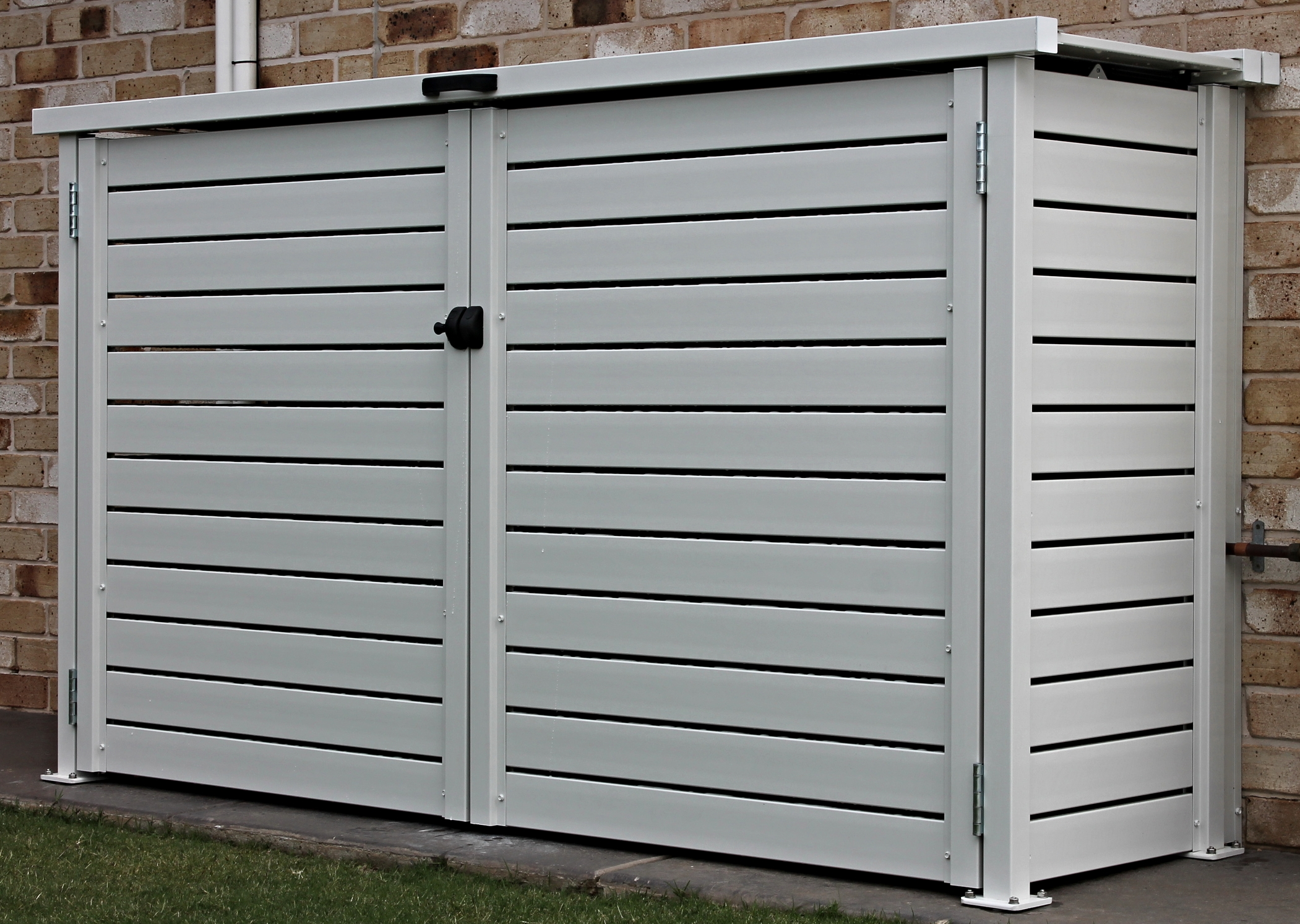 Privacy screen built to conceal and protect pool pumping equipment