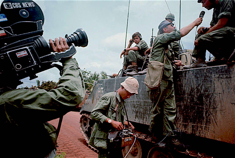 CBS camera crew interviewing American troops in Vietnam, 1967. (Photo by Tim Page/Corbis)