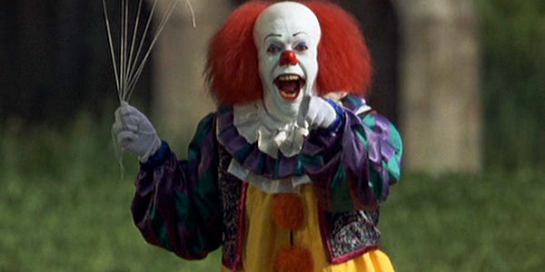 Tim Curry as Pennywise the Dancing Clown in  IT  (1990).