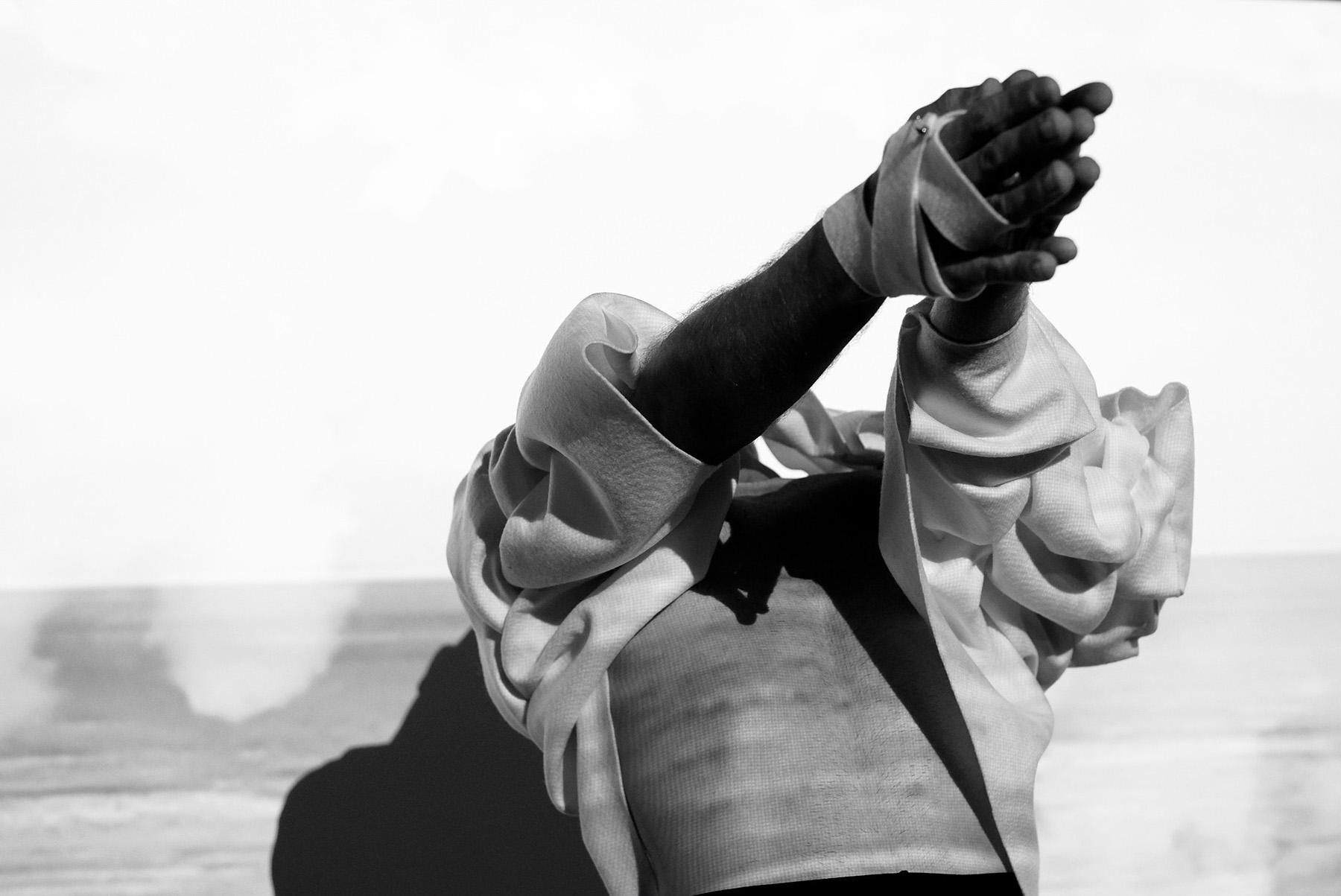 BRUTALIST #7.0 - CLOUD (reversible) : merino wool felt l bonded thread l stainless steel studs  image : Suzanne Phoenix l projection : Zakaria Garmsiri l hmua : Jessi-Leigh O'Halloran l model : James Andrews