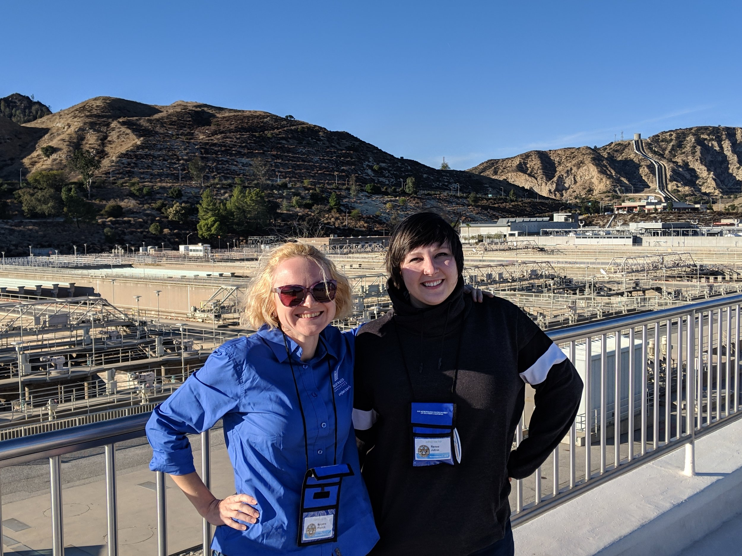 Maryana and Renee from Valor at the Jensen Water Treatment Plant, with the Los Angeles Aqueduct in the background.