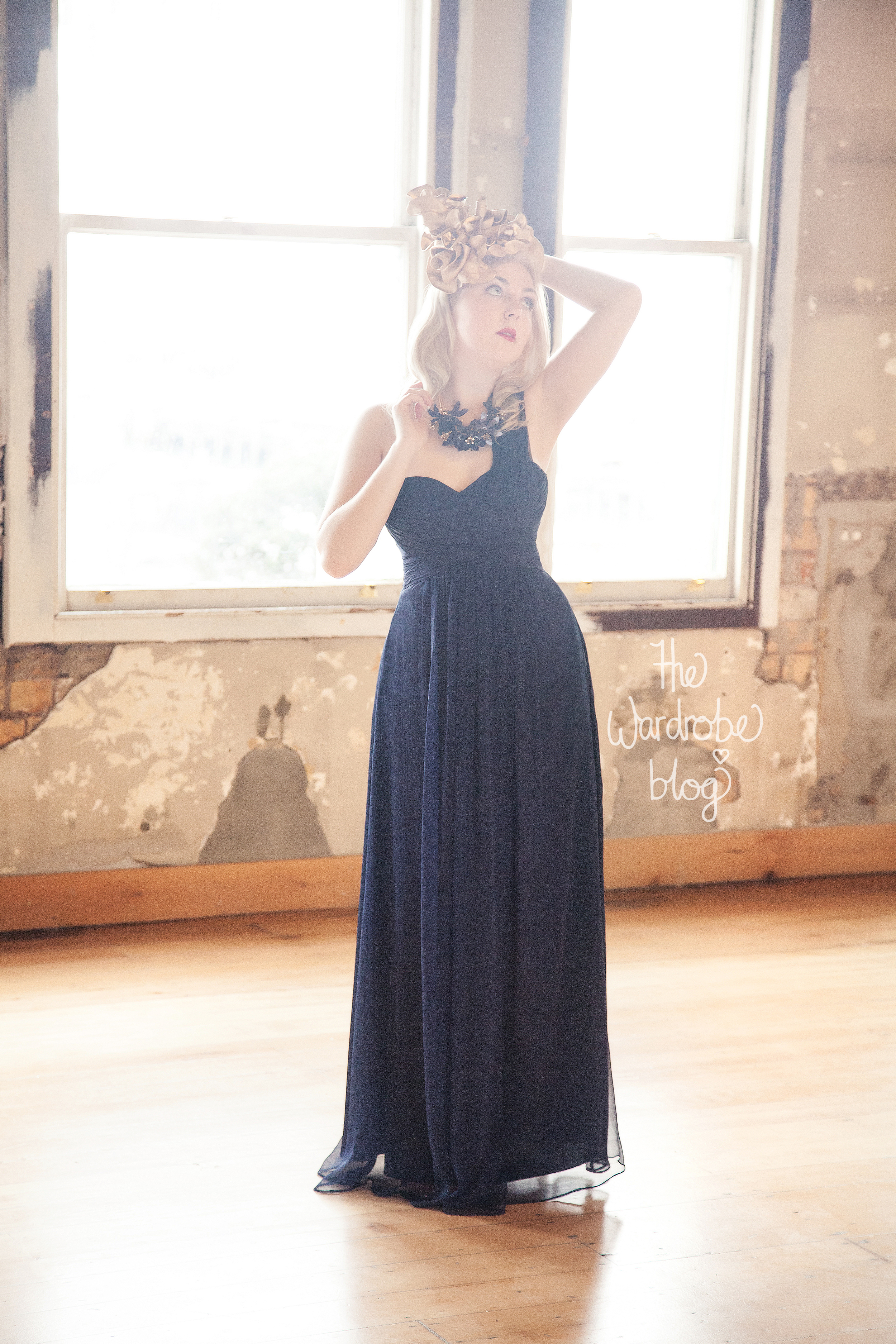 Gown from Hera Bridal in Navy, Headpiece + Necklace from Claire Hahn.