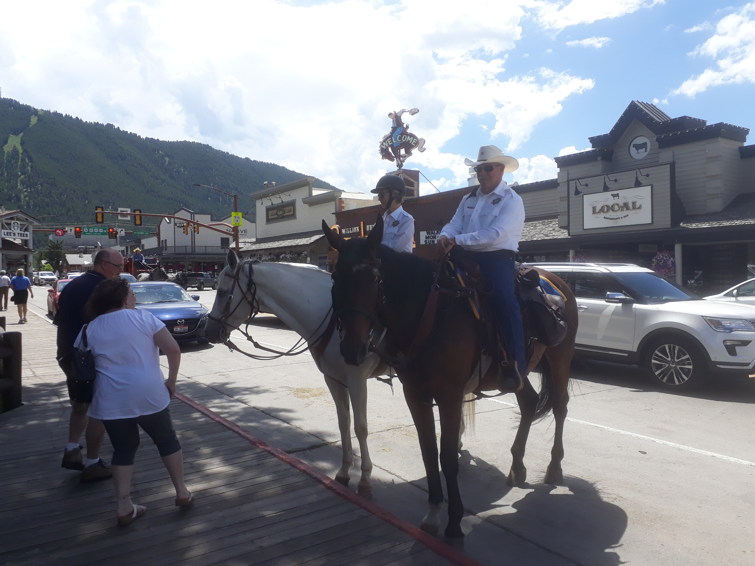 "Before I got to the airport my roomies with a car drove me into Jackson for a little touristing. We saw police on horses. I asked why he got to wear a cowboy hat while she got to wear a helmet. She said, ""Cause I'm the smart one."""