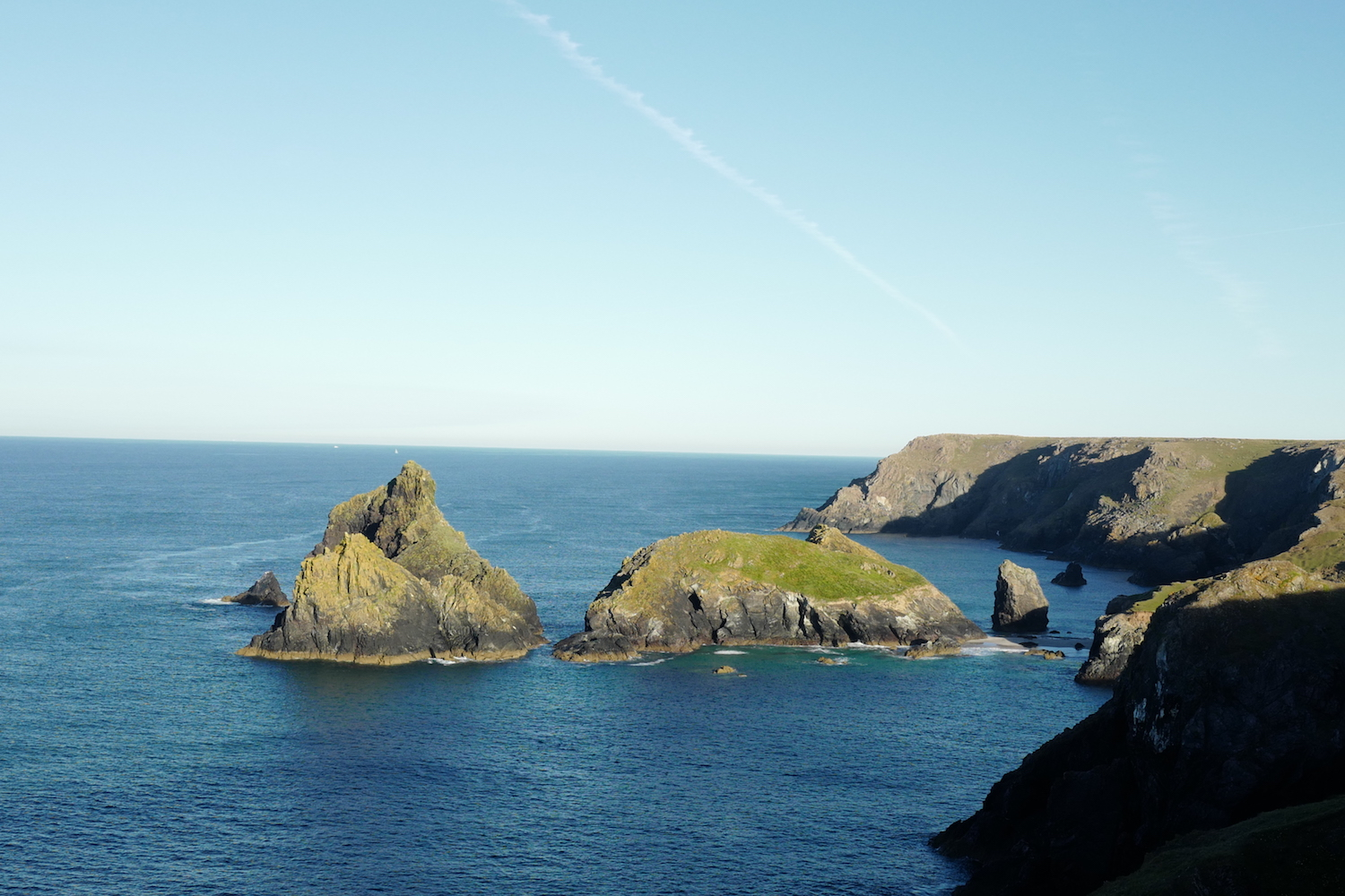 A cliff view of Kynance Cove at high tide