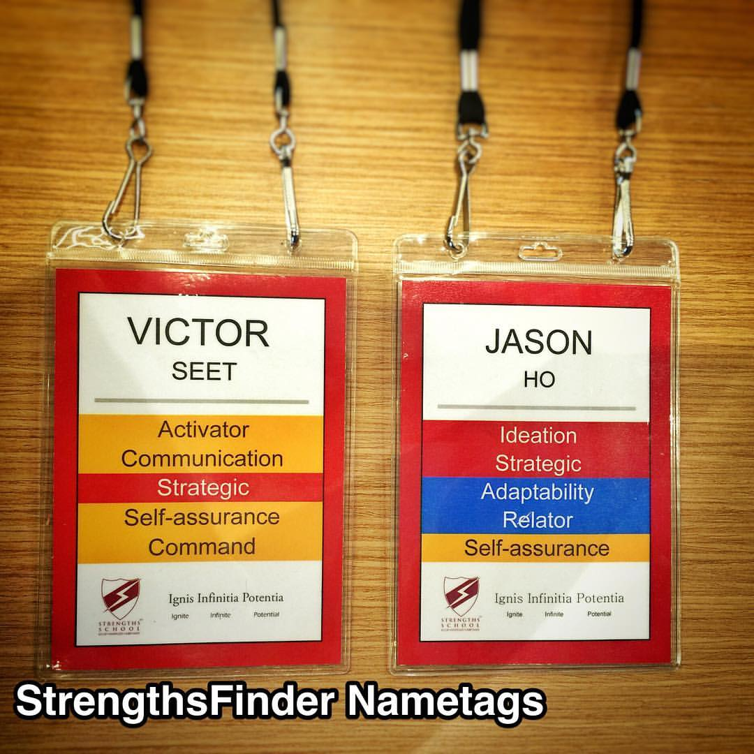 "Probably the most colorful #StrengthsFinder tags in #Singapore & the world. Thanks to the brilliant Victor Seet using his StrengthsFinder talents of Strategic & Communication    Question: What is the most Strategic way for a participant to know their top 5 StrengthsFinder talent themes as well as Communicate which 'Domain of Leadership' they are dominant in? Victor's answer: Domain-colored name tags    EXECUTING - Purple  Those with dominant themes in this domain know how to make things happen. When the team needs someone to implement a solution, these are the people who will work tirelessly to get it done. Those with a strength to execute have the ability to ""catch"" an idea and make it a reality    Achiever, Arranger, Belief, Consistency, Deliberative, Discipline, Focus,Responsibility, Restorative    INFLUENCING - Yellow  Those with dominant themes in this domain help their team reach a much broader audience. These individuals can sell the team's ideas inside and outside the organization. When the team needs someone to take charge, speak up, and make sure the group is heard, look to someone with the strength to influence    Activator, Command, Communication, Competition, Maximizer, Self-Assurance, Significance, Woo    RELATIONSHIP BUILDING - Blue  Those with dominant themes in this domain can provide the essential glue to hold a team together. Without these strengths on a team, in many cases, the group is simply a composite of individuals. In contrast, team members exceptional in this domain have the unique ability to help the group become much greater than the sum of its parts    Adaptability, Developer, Connectedness, Empathy, Harmony, Includer, Individualization, Positivity, Relator    STRATEGIC THINKING - Red  Those dominant in this domain are the ones who keep the team focused on what could be. They are constantly absorbing and analyzing information and helping the team make better decisions. People with strength in this domain continually stretch the team's thinking for the future    Analytical, Context, Futuristic, Ideation, Input, Intellection, Learner, Strategic    #StrengthsQuest #StrengthsSchool #Gallup Jason Ho • SouthEast Asia's 1st StrengthsFinder Certified Coach"