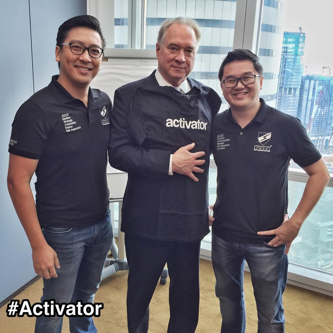 "#Gallup CEO with #StrengthsFinder coaches in #Singapore      We have the honor of meeting Jim Clifton, CEO of Gallup, on Monday and we gave him the #Activator #strengthstees as a gift from Strengths School.     One quote from Jim that resonated with us:  ""My dad (Don Clifton, creator of the StrengthsFinder tool) mentioned to me ""imagine the conversations that people can have around their strengths!""     Jim shared the Strengths Movement was activated globally by the creation of the Strengths coaches community. While StrengthsFinder existed for many years, the Strengths Movement exploded when the coaching community was set up. He shared compellingly that the most powerful way to activate people's talents is not through the person's results but through the conversations. The coaches thus become the catalysts in the Strengths Movement because of the conversations they facilitate.    The quote is a powerful statement about coaching and that is a key reason that explains Strengths School's existence. We facilitate the rich conversations that revolve around what is right with people.    Jim Clifton truly activated our hearts and further empower us to live out our vision - ""Seeing every generation live out their full potential!""     A Big Thanks to Jim!    #StrengthsQuest #StrengthsSchool #StrengthsFinderSG #Asia #HumanResource #SelfImprovement #SelfDevelopment #TrainingAndDevelopment #ProfessionalDevelopment #StrengthsFinderCoach    Jason Ho • SouthEast Asia's 1st StrengthsFinder Certified Coach • Strengths School™ Singapore"