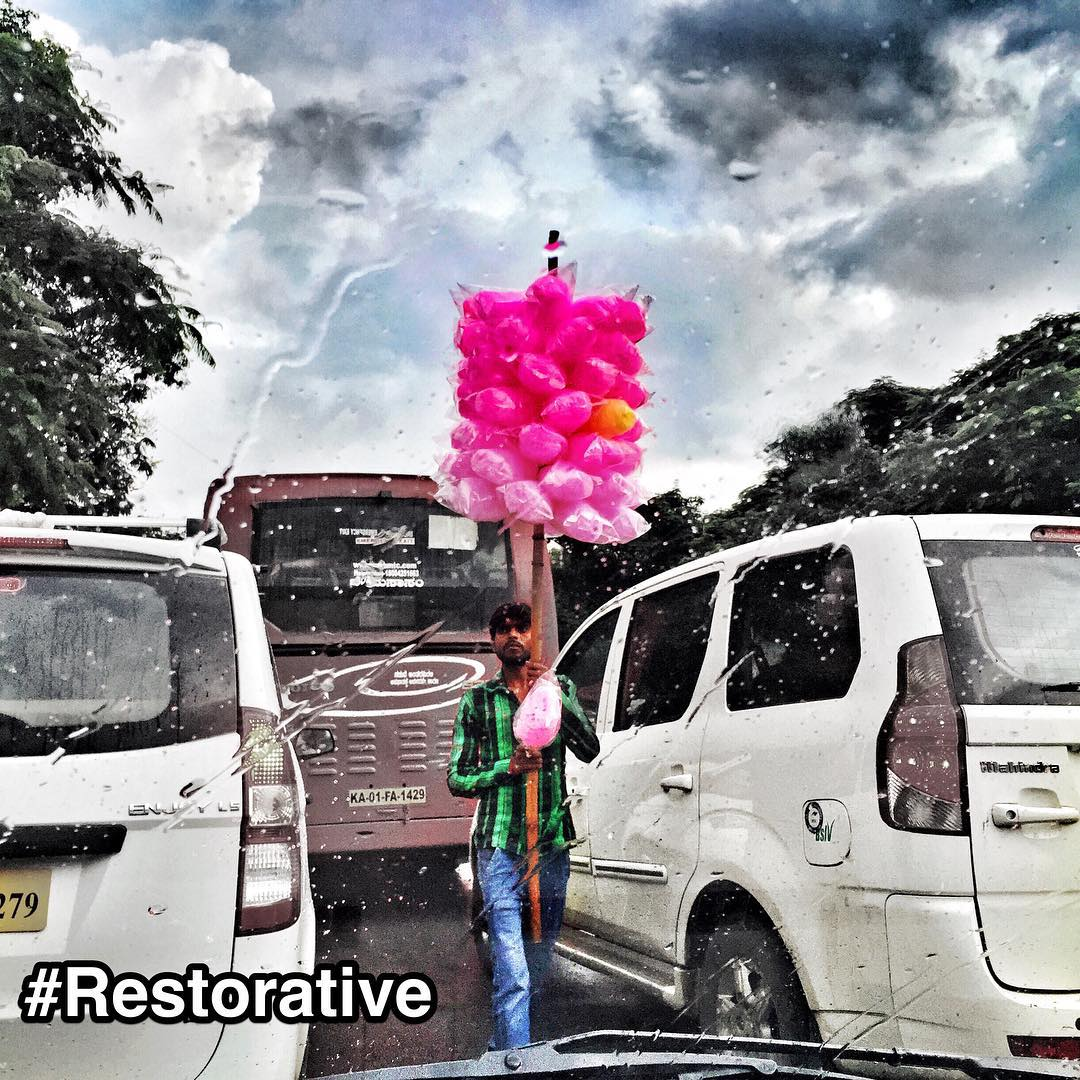 "#StrengthsFinder #Restorative in #India. If only #Singapore had such an amazing sight.     This is such an ingenious way of carrying cotton candy along the busy streets of #Bangalore. For people with StrengthsFinder Restorative, they enjoy fixing problems and coming up with quick practical solutions.     Best described by the StrengthsFinder Restorative definition:     ""The genius of Restorative talents is in your love of problems. While others shy away, your solution-oriented mind naturally gravitates toward these challenges.""    Problem: need to carry 51 pink & 1 yellow cotton candy packets through narrow spaces between traffic. Require easy access to the cotton candy to sell when vehicles come to a stop.    Restorative solution: put all 51 pink & 1 yellow cotton candy on a long stick held vertically. The height of the cotton candy would be above the cars and vans so as to maintain slim human profile for the holder. All this whilst effortless squeezing through densely congested roads.    And for this, children all over India can now enjoy. Waiting.     #StrengthsQuest #StrengthsSchool #StrengthsFinderSG #Asia #HumanResource #Gallup #SelfImprovement #SelfDevelopment #TrainingAndDevelopment #ProfessionalDevelopment #StrengthsFindercoach     Jason Ho StrengthsFinder Coach • Strengths School™ Singapore"