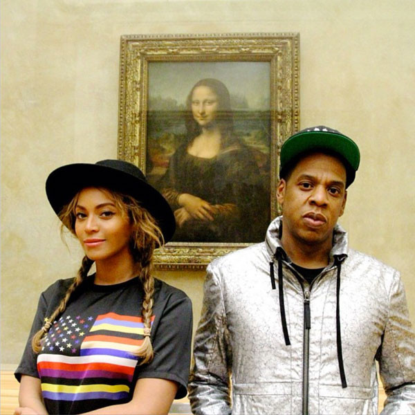 Beyoncé and Jay Z, with the Mona Lisa at the Louvre. Photo via: Twitter