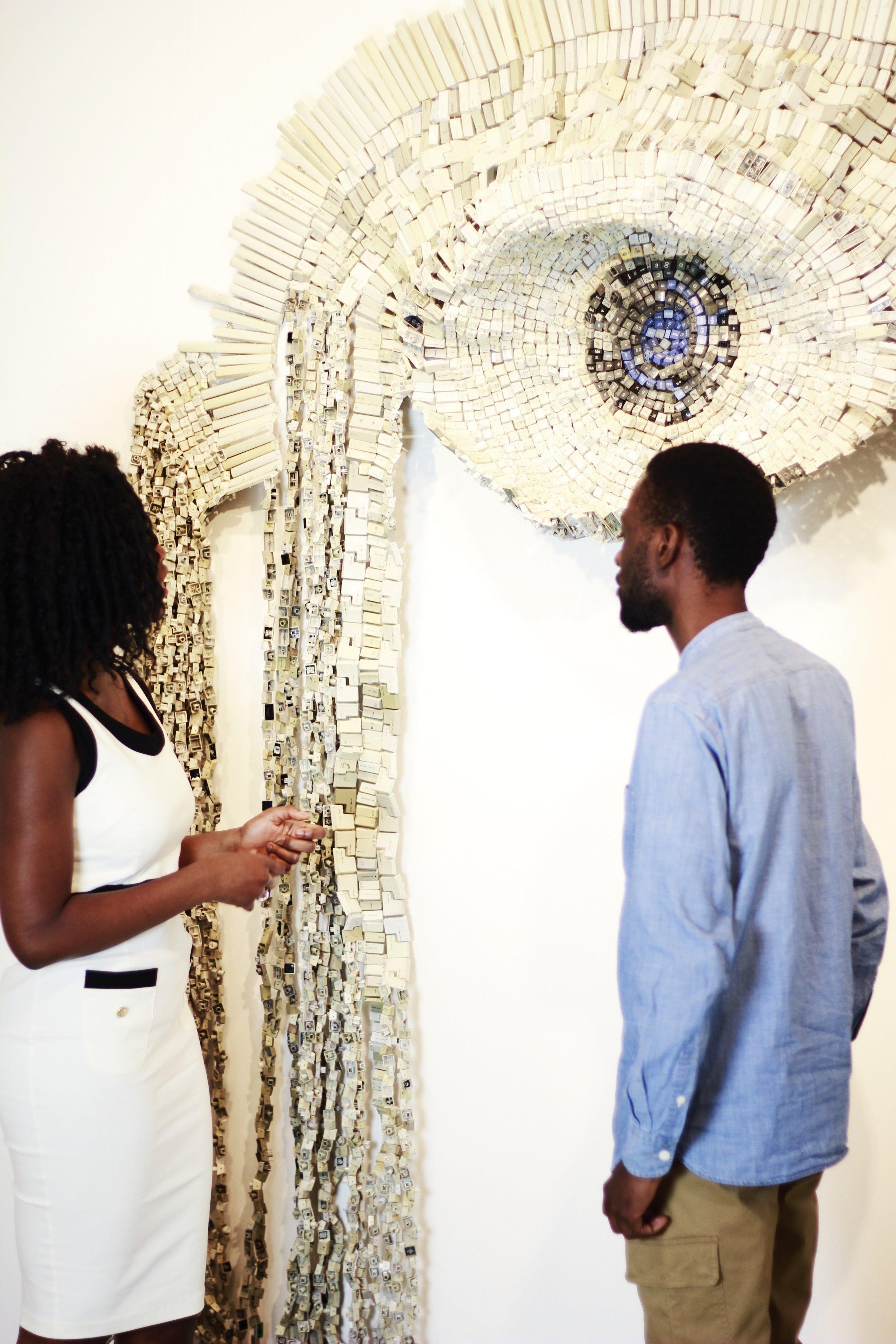 Sharon Obuobi with Moffat Takadiwa in front of  Judging by Language , 2017.