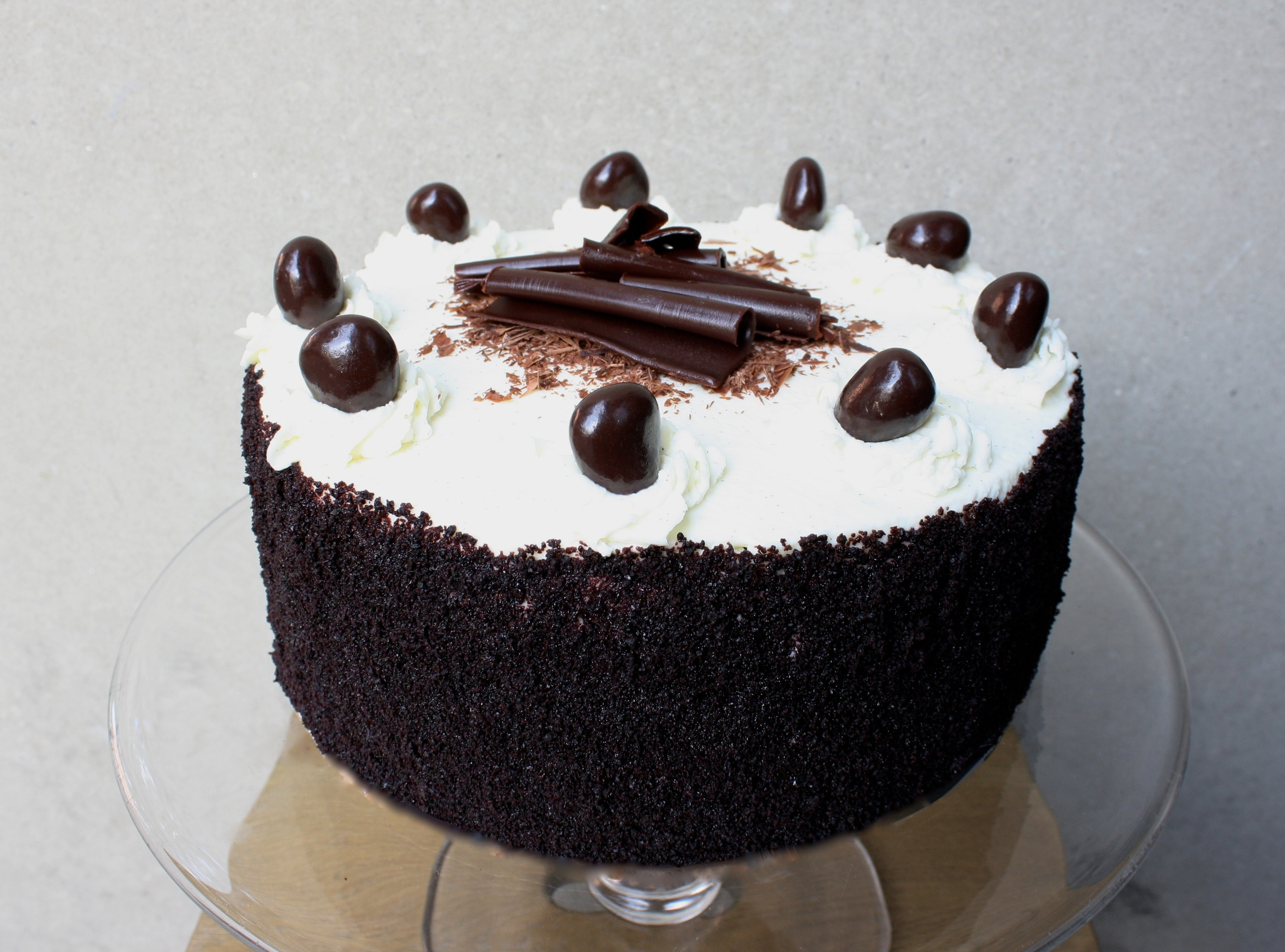 Black Forest*  Rich chocolate cake soaked in cherry liqueur and layered with brandied cherries, iced with homemade whipped cream, and finished with chocolate cake crumbs, chocolate-covered cherries, and dark chocolate curls