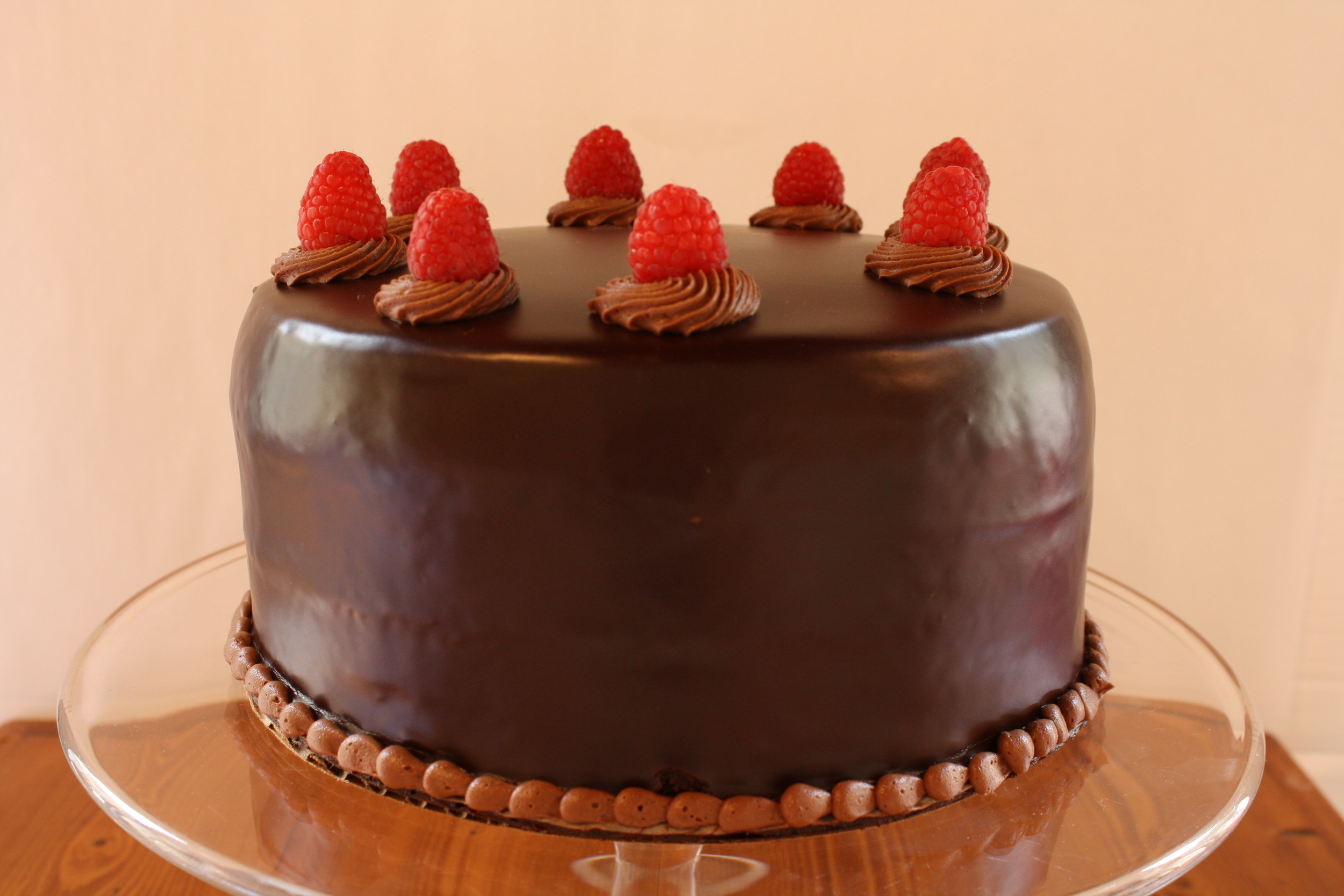 raspberry chocolate ganache*  moist chocolate cake layered with raspberry filling, and covered with CHOCOLATE ganache and fresh raspberries