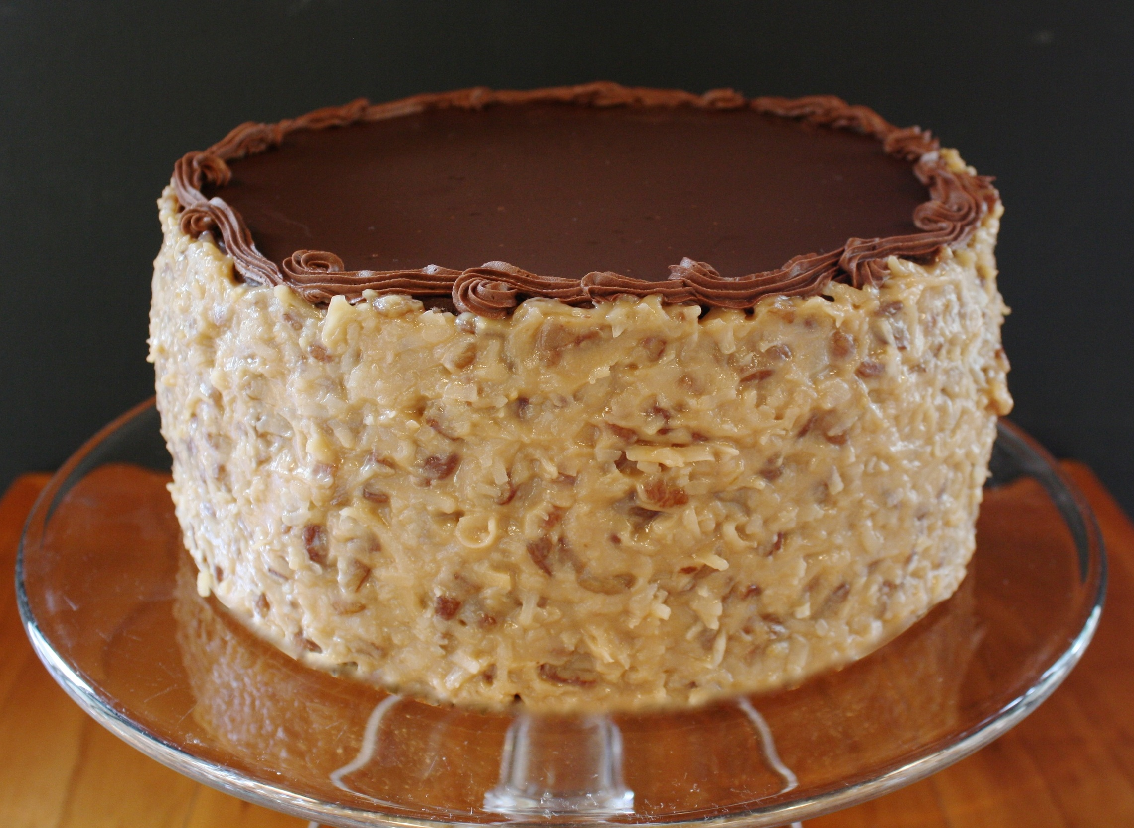 German chocolate*  A delectable CHOCOLATE cake layered with coconut-pecan frosting and decorated with minced pecans