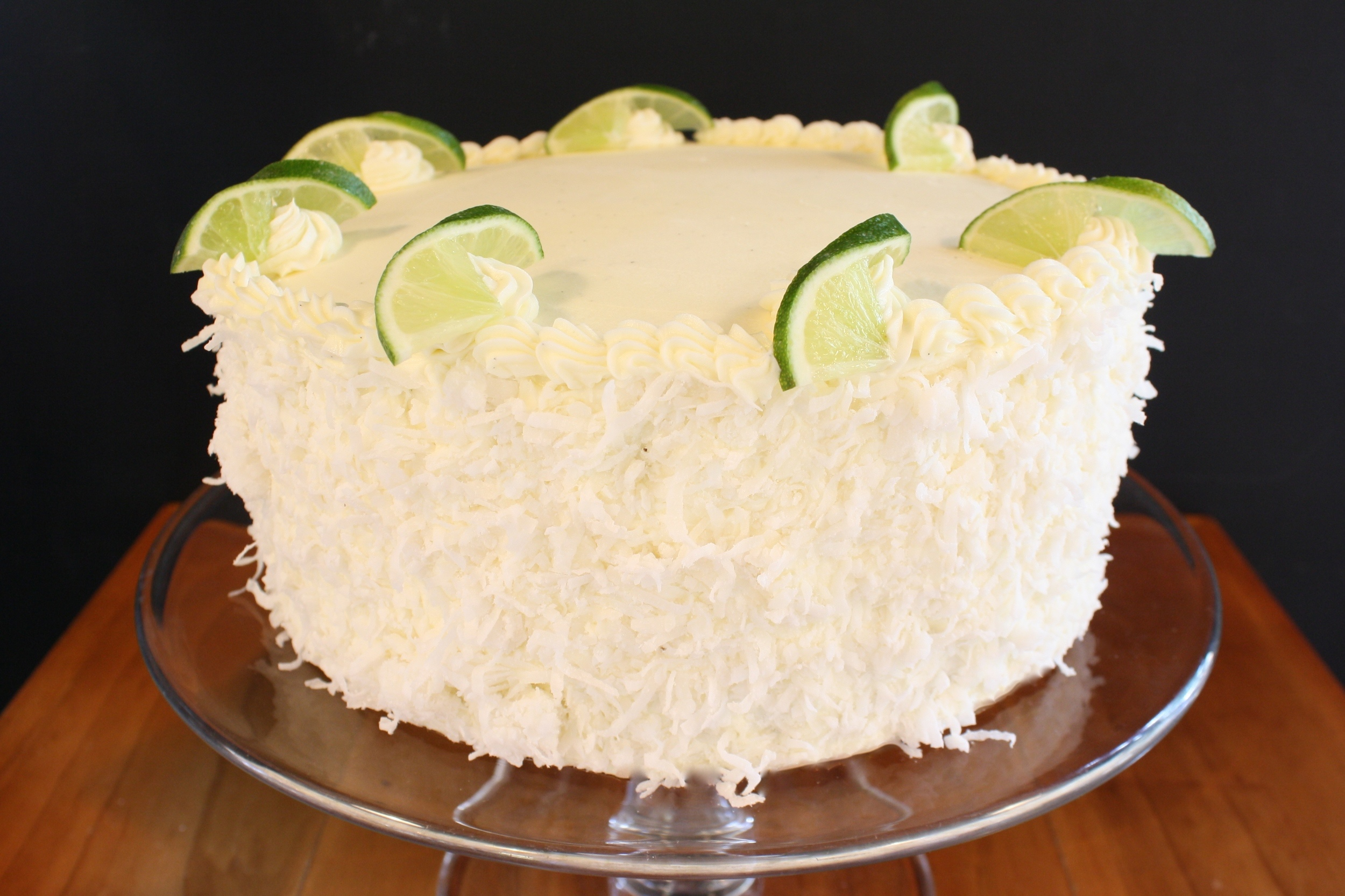 Coconut lime curd*  an ambrosial coconut cake layered with housemade lime curd, frosted with coconut buttercream and decorated with shredded coconut