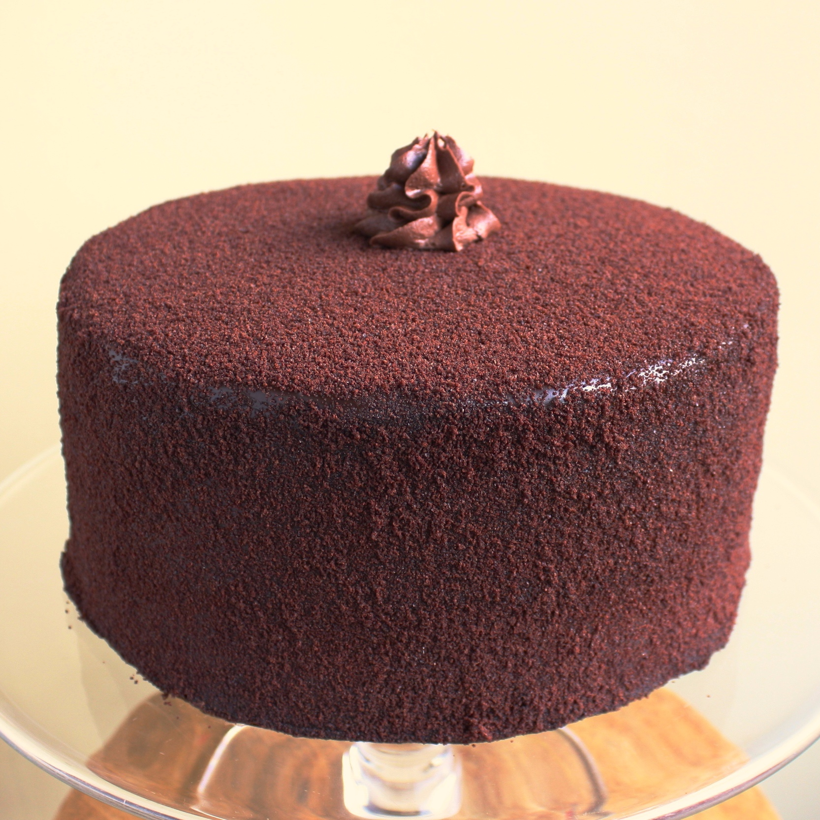 Devil's food*  a rich chocolate cake layered with chocolate ganache and caramel, iced with chocolate ganache, and dusted with chocolate cake crumbs