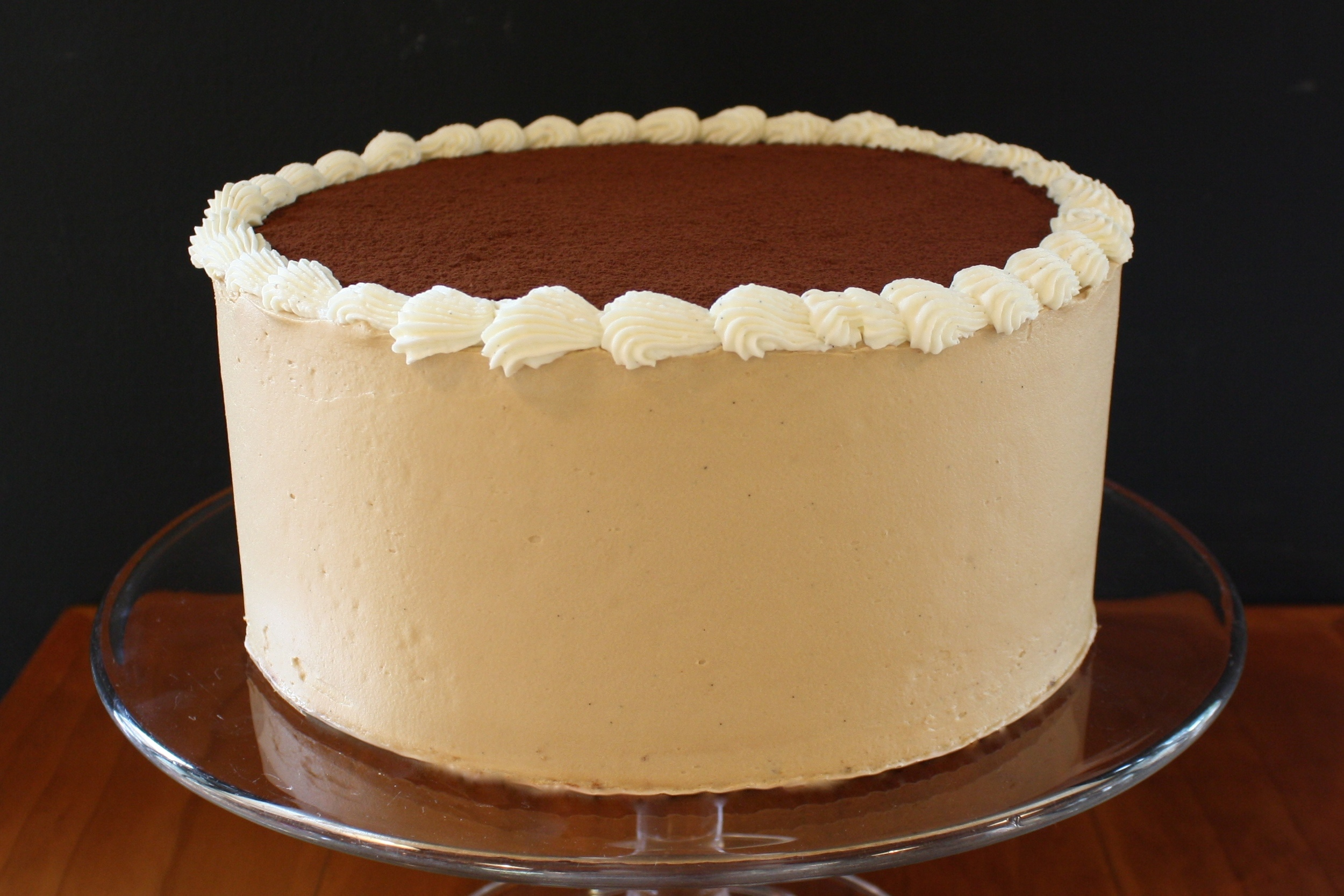 """TIramisu*  THE CLASSIC ITALIAN """"PICK-ME-UP"""" IN TRIPLE-LAYER CAKE FORM: VANILLA CAKE SOAKED IN ESPRESSO AND BRANDY, LAYERED WITH COCOA AND MASCARPONE FILLING, AND FINISHED WITH COFFEE ICING"""