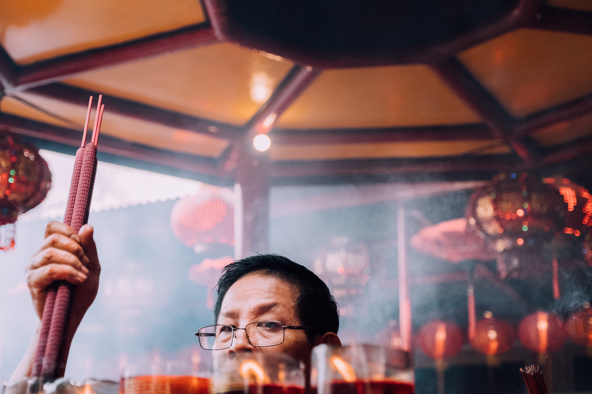 A man lighting candles at a Chinese Lunar New Year event in Jakarta.