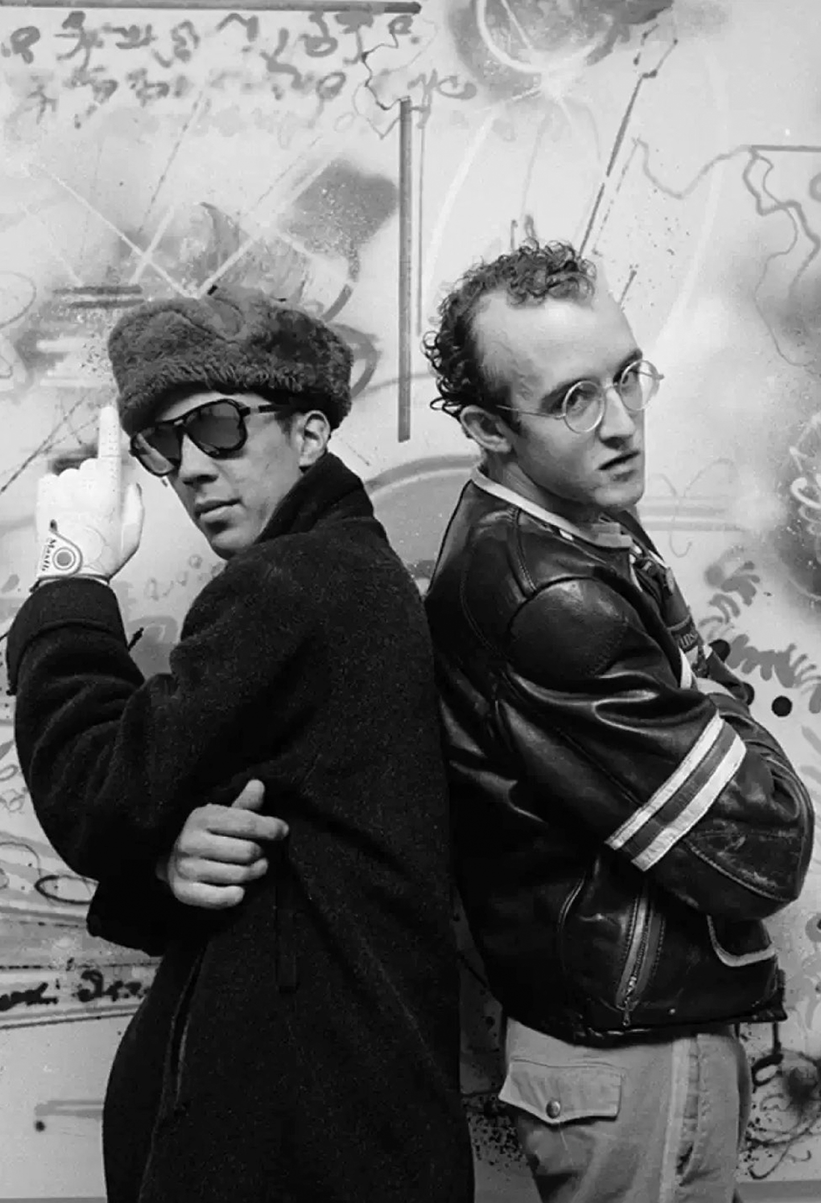 Graffiti artist Futura 2000 on his opening night at Fun Gallery, with Keith Haring. Photo by the Sophie Bramly in 1983.