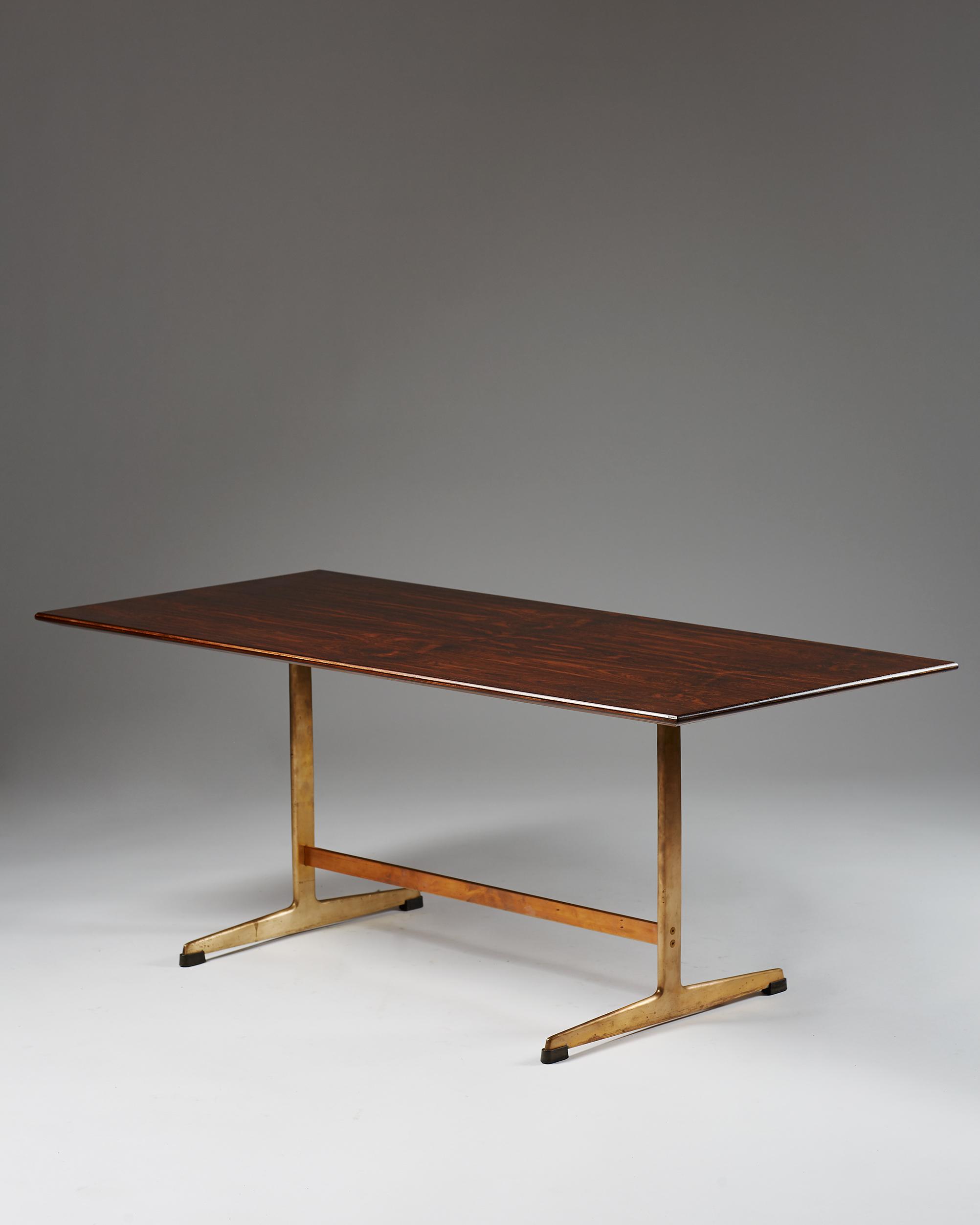 Arne Jacobsen  Coffee table Denmark, 1950's Bronze and rosewood. 47 x 120 x 55 cm