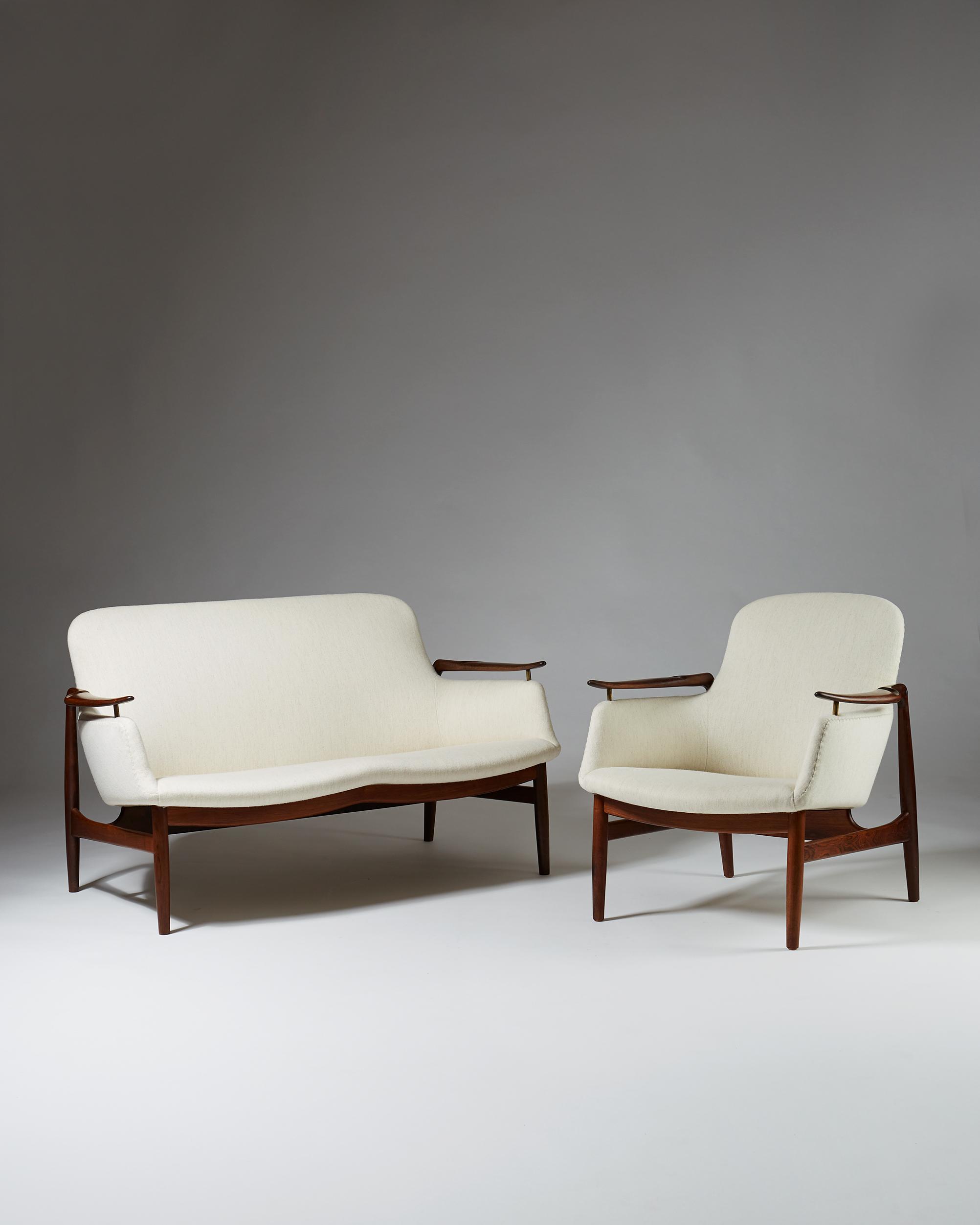 Finn Juhl  Sofa and armchair FJ 53 Denmark, 1953 Wool upholstery and Brazilian rosewood.  Sofa: 73 x 128 x 72 cm Seat: 36 cm  Armchair: 75,5 x 71 x 63 cm Seat: 34 cm