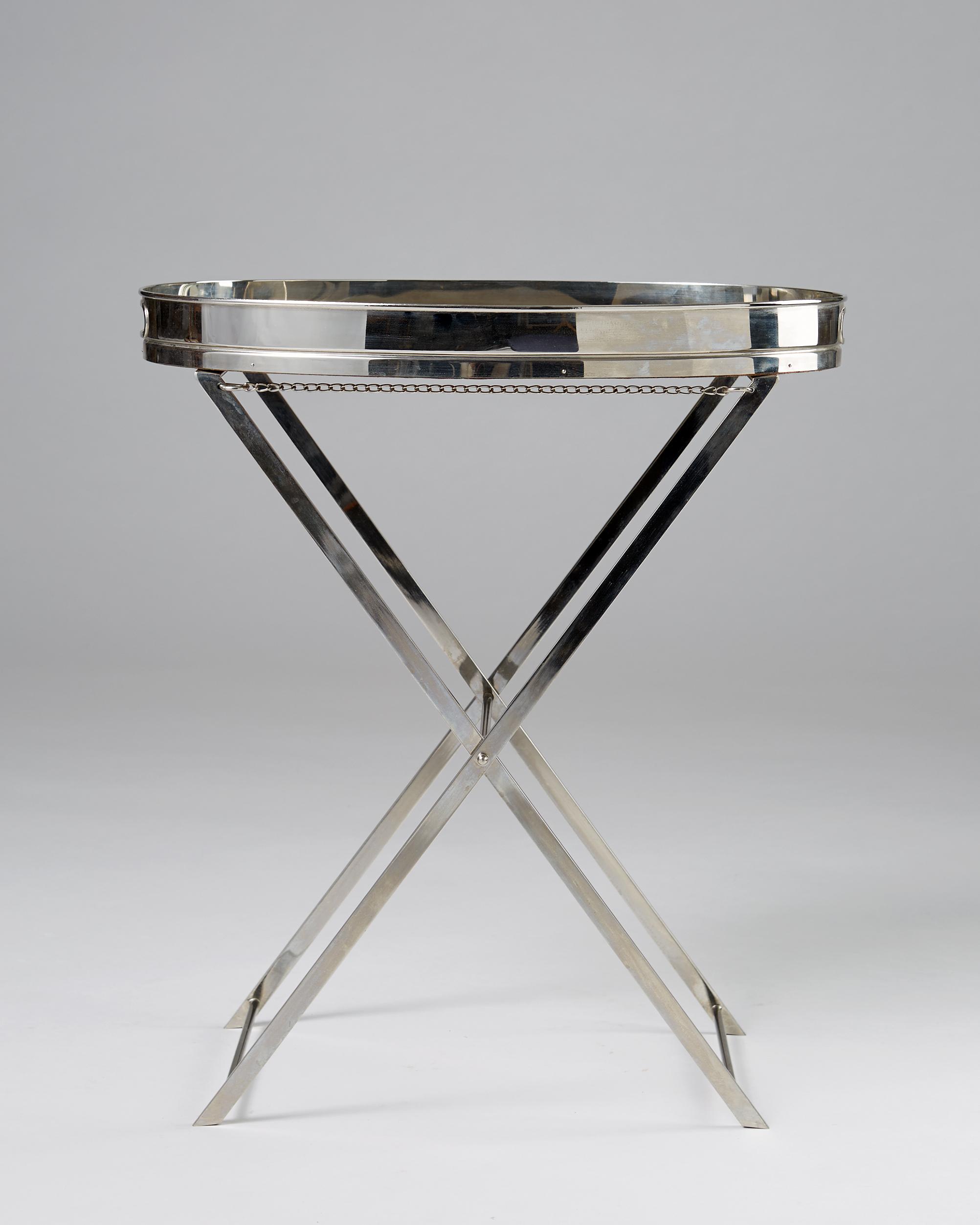 Svenskt Tenn  Tray table Sweden, 1980's Chromed plated metal. 53 x 55,5 x 37 cm