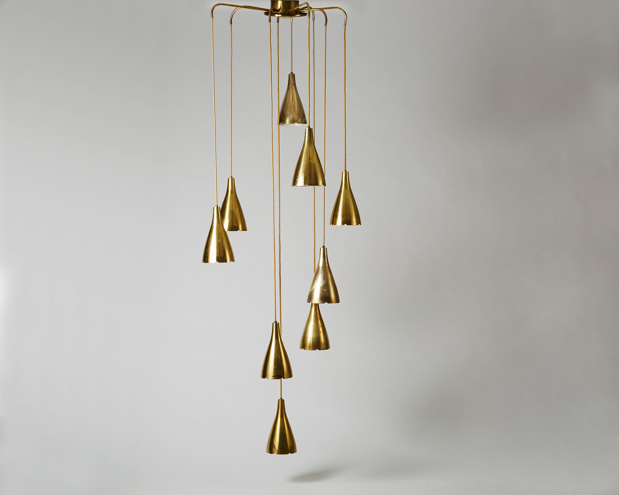 Paavo Tynell  Ceiling lamp, model 1994/9 Finland. 1950's Brass.  Total fixture: 217 x 78 cm  Each Lampshade: 26 x 15 cm