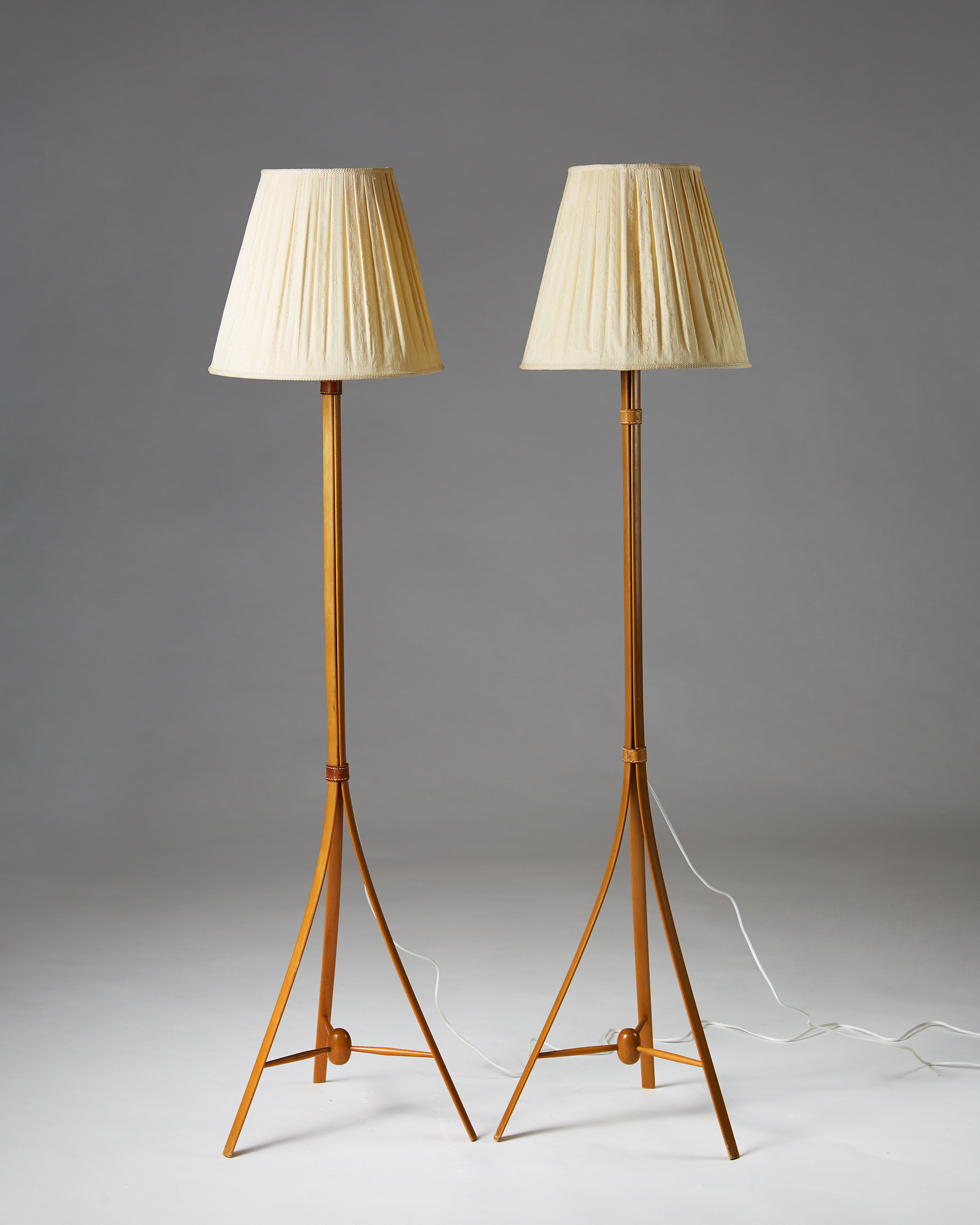 Alf Svensson  Pair of floor lamps Sweden, 1950's Beech, leather and fabric shade. 154 x 42 cm Foot D: 39,5 cm