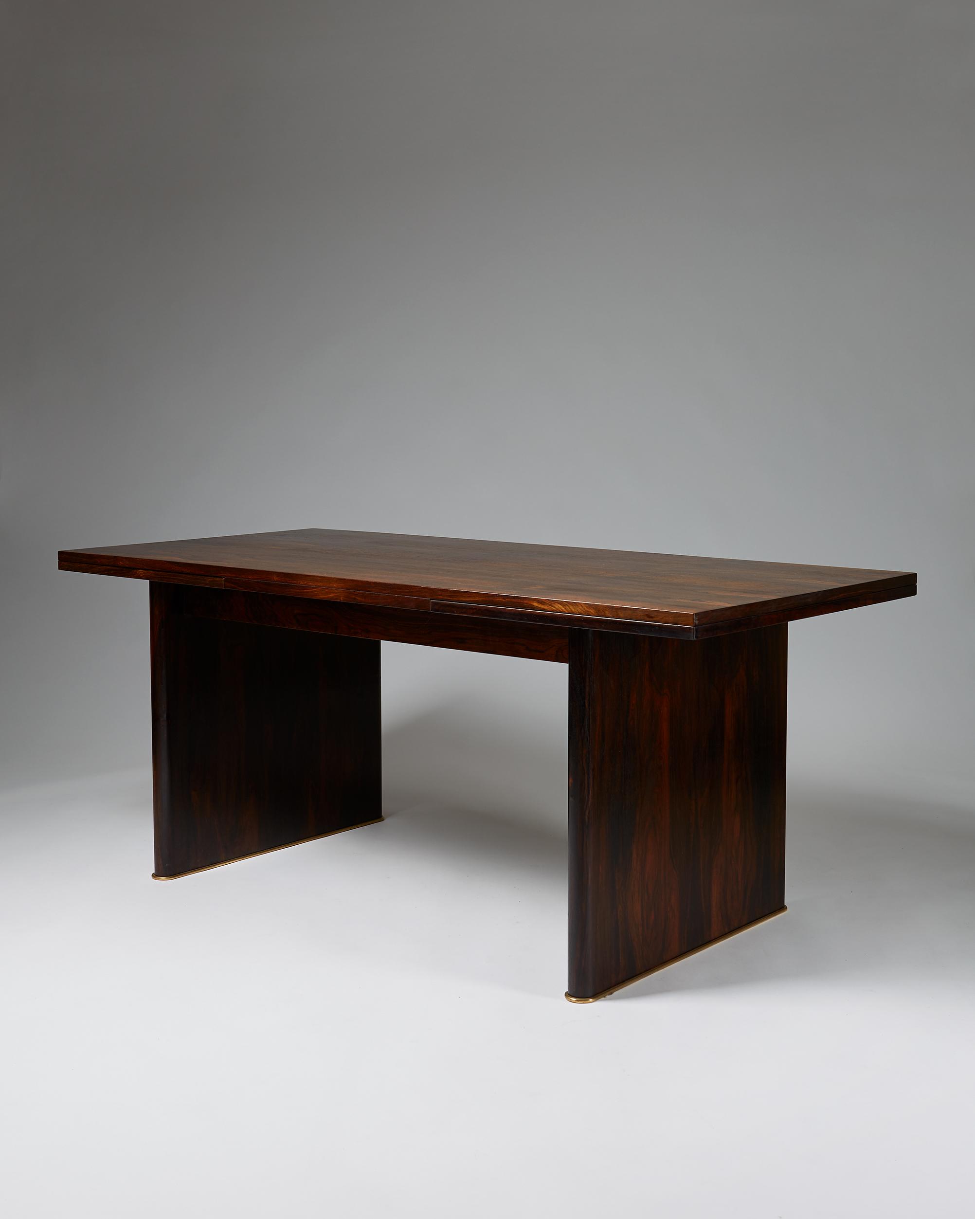 Ernst Kühn  Dining table Denmark, 1930's Brazilian rosewood and brass base. 76 x 180-300 x 85 cm
