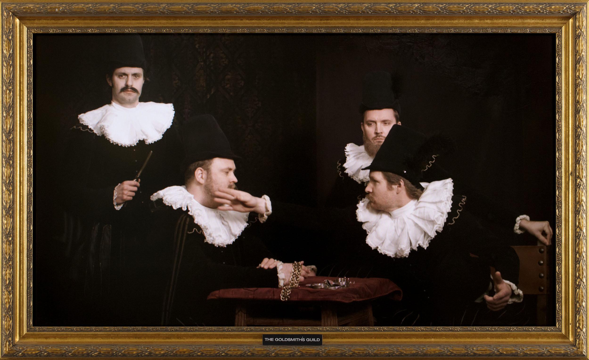 Jonathan Knape   Parafresk 1.0, The syndics of the goldsmiths' guild  2013 Signerad a tergo. Installation med videoverk, tv-skärm,  tavelram, DVD-spelare, träpodium 204 x 160,5 x 25 cm