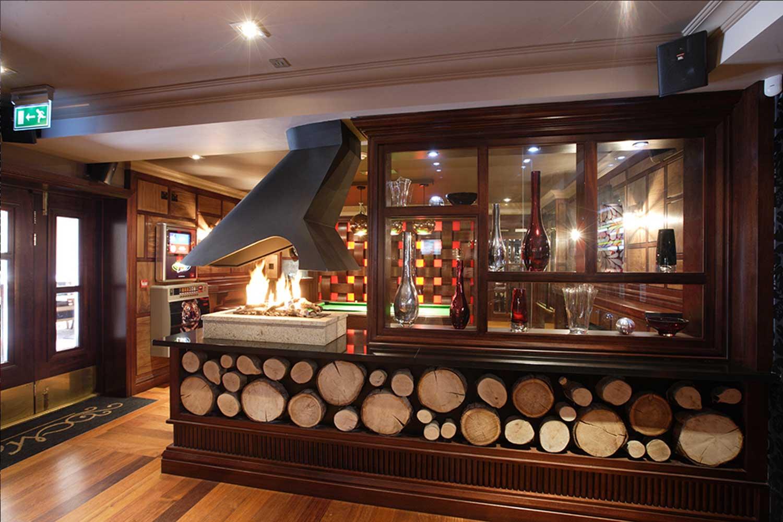 Malone's Irish Pub - wooden log interior design