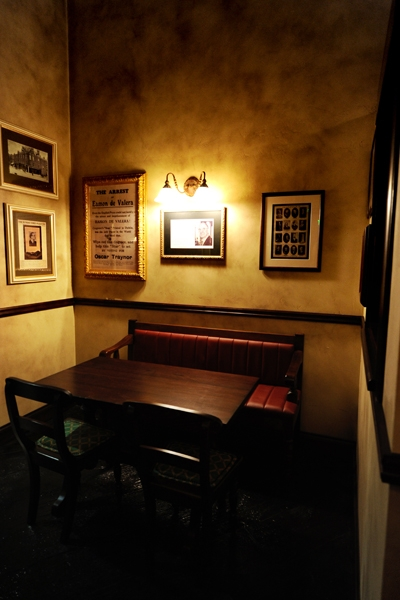 de Vere's authentic Irish pub design - interior seating low wooden table with leather upholstered seating