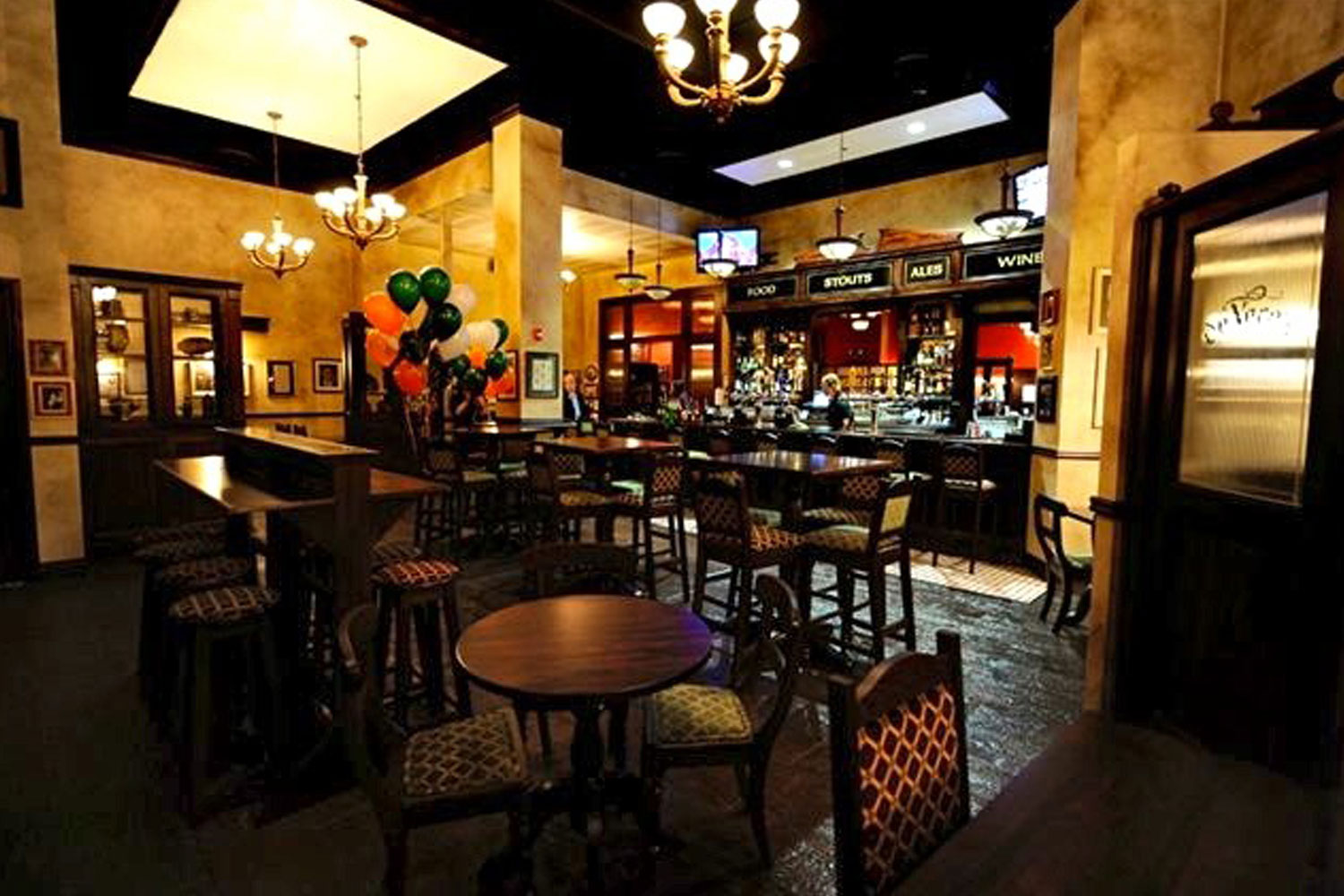 de Vere's Irish pub design interior view of wooden high tables and backed stool seating