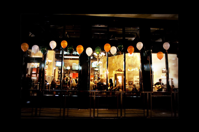 de Vere's authentic Irish pub design - exterior view with balloons in the Irish tri-colours; green, white and orange