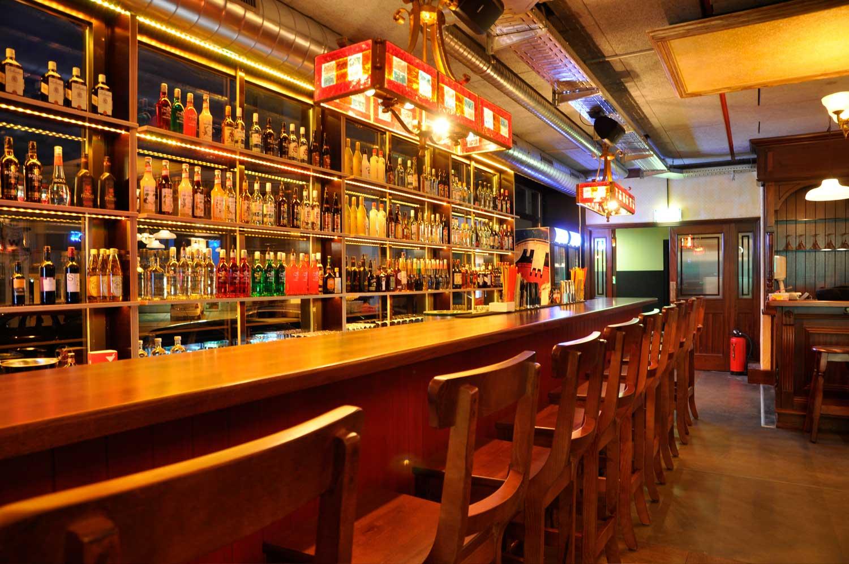 Peggy O'Neil's Irish bar design - interior view of wooden bar and stool