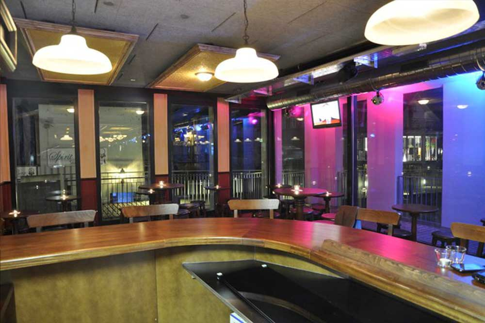 Peggy O'Neil's authentic Irish pub design - interior wooden bar from barman's perspective