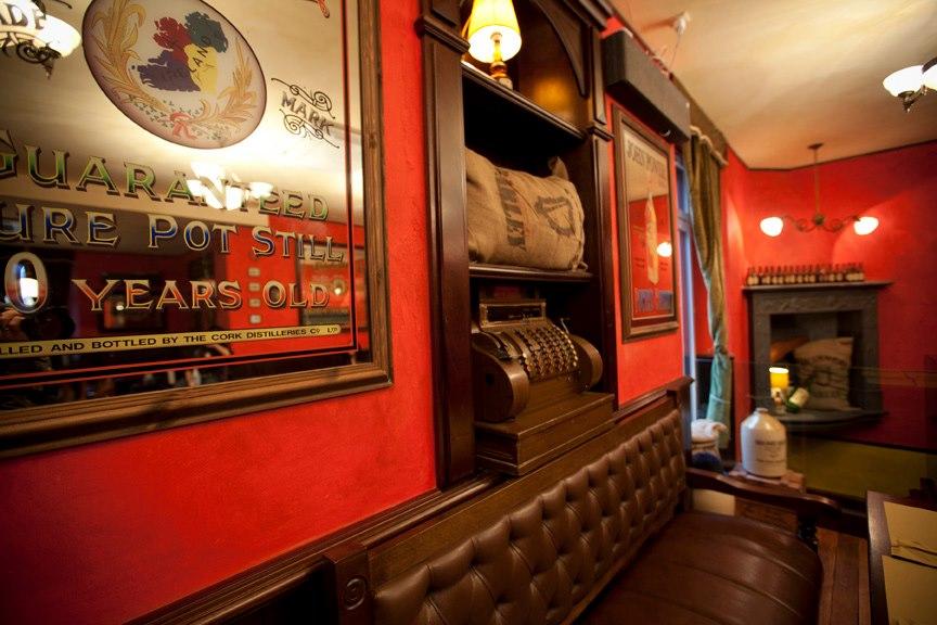 Trinity Irish pub design - authentic Irish mirror with map of Ireland, hession Guinness bag and Irish trinkets
