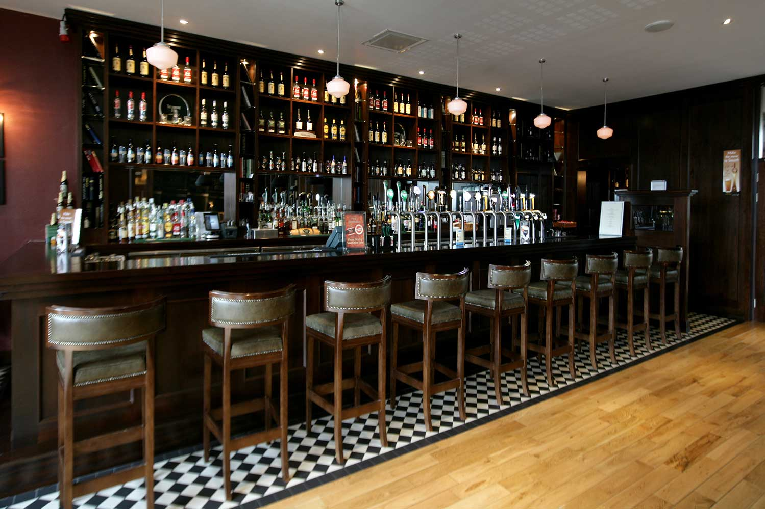 Bewley's Hotel Bar design - interior view of bar with stools lined up