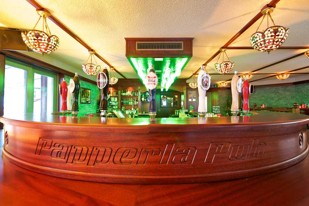 Papperla authentic Irish pub design - wooden bar with 'Papperla Pub' engraving