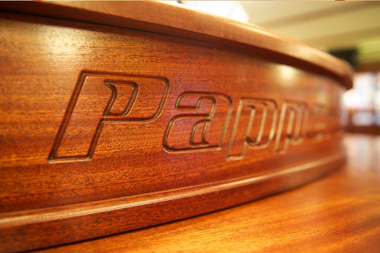 Papperla authentic Irish pub design - wooden engraving on bar