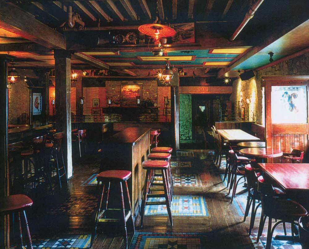 The Country Shop Irish Pub Design - interior view of high wooden counters and stools with a red wood finish.