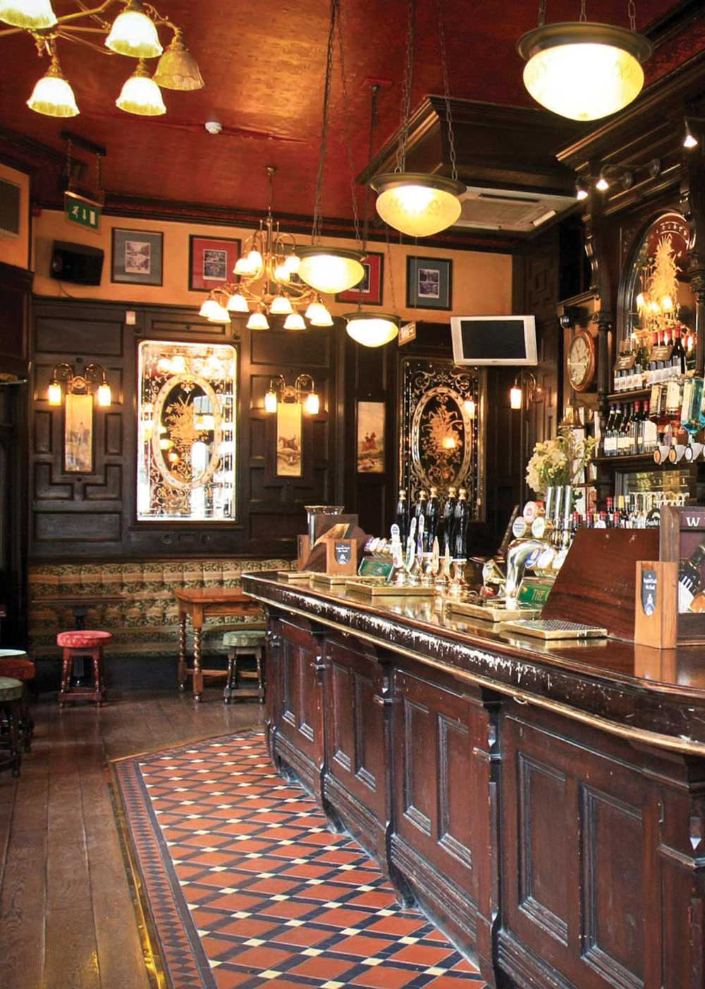 Country Cottage authentic Irish Pub Design  - view of interior bar soft yellow lighting decorated with Irish trinkets.