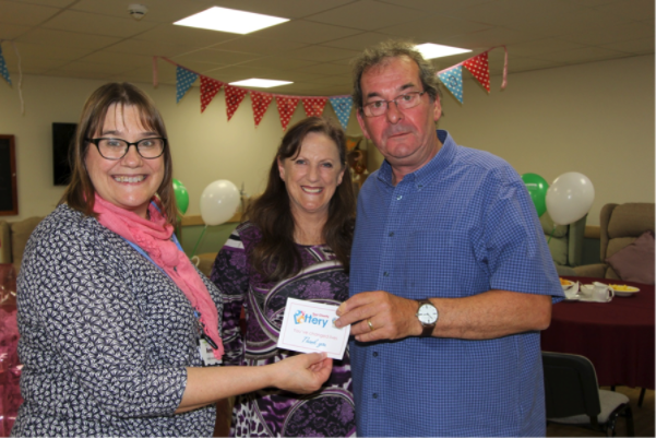 Alan Robinson, our first ever jackpot winner, here pictured receiving his Founder Member Badge.