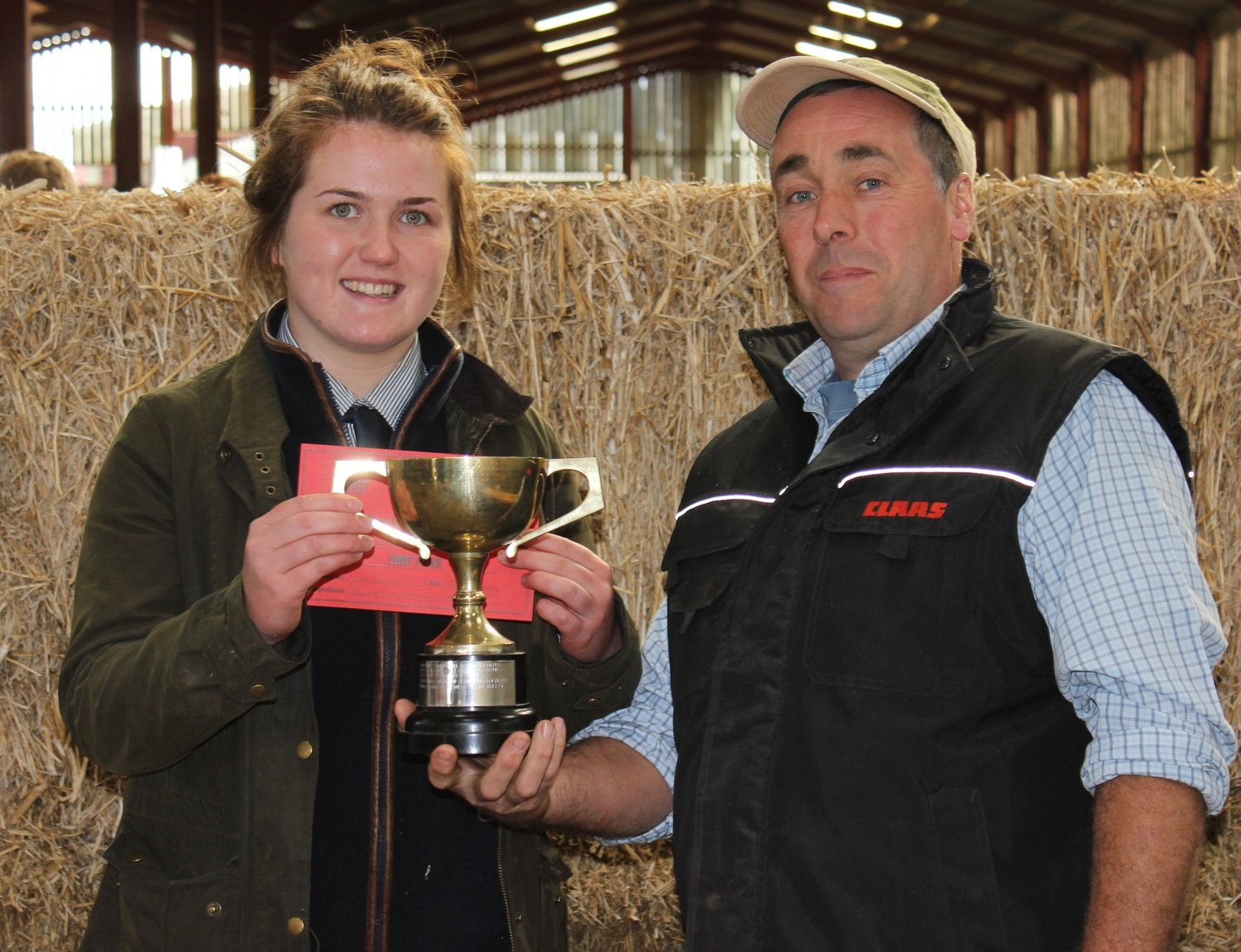 Junior Stockman of the Year Winner - Ella Harris Teme Valley YFC being presented with her trophy from venue host Christopher Morris.