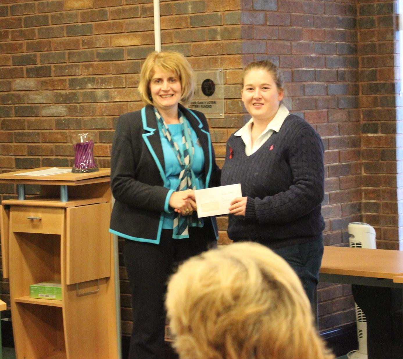 Teme Valley YFC Chairman Kim Barnett receiving the £150 Bursary from judge Jen Thomas